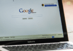 Laptop opened to Google browser window. In May of 2019, it appears that a change was made in Google's Algorithm for search. What is the impact of Google and Local Business?
